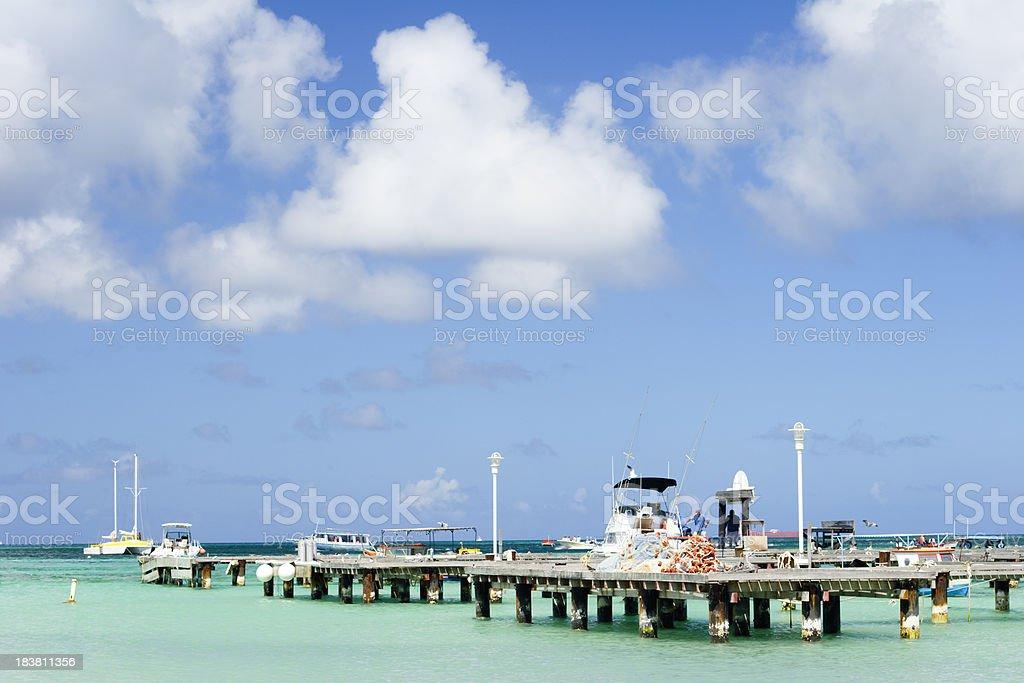 Pier off Aruba Palm Beach stock photo