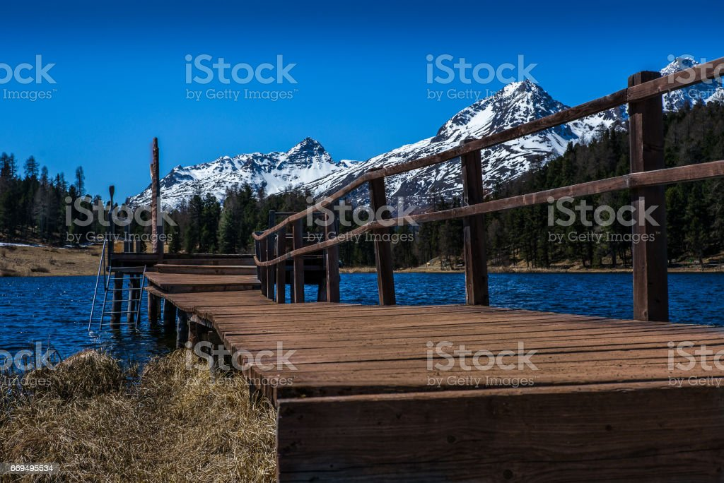 Pier on Alpine lake in Engadin - 1 stock photo