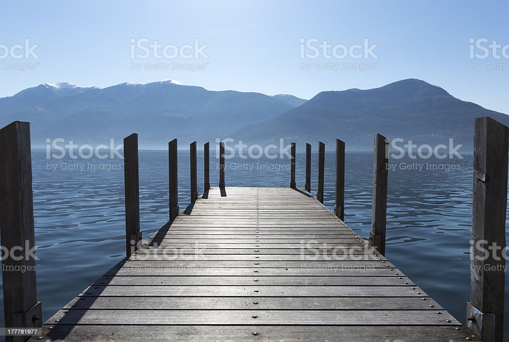 Pier on an alpine lake royalty-free stock photo