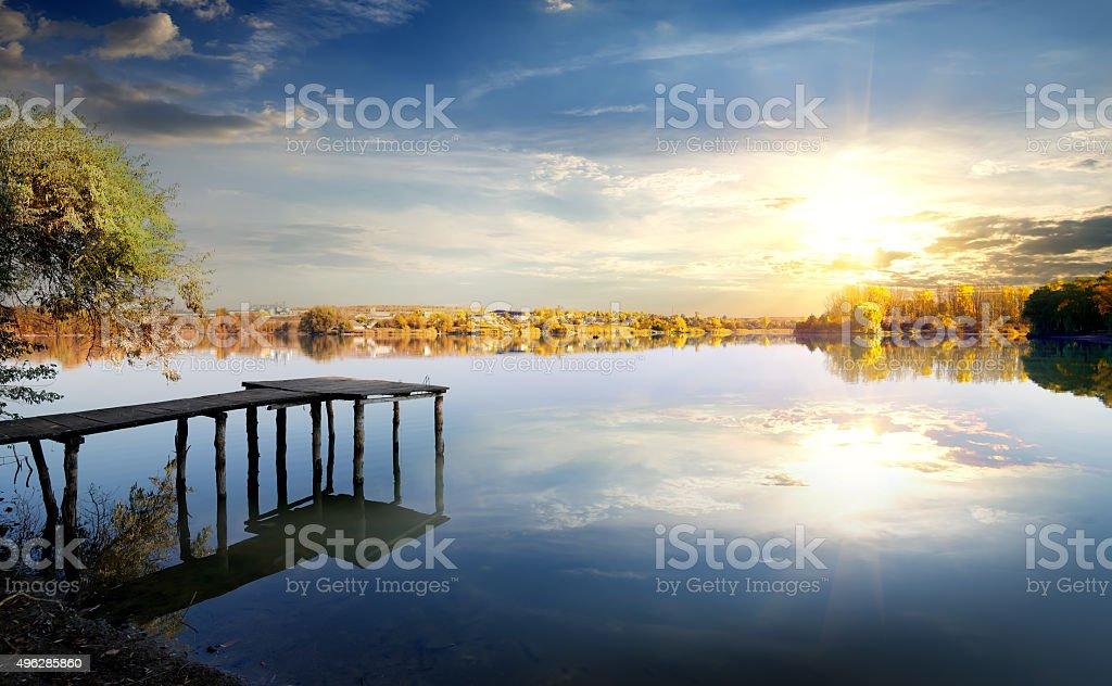 Pier on autumn river stock photo