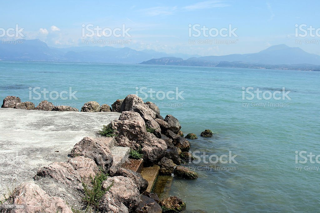 Pier on lake in Italy. stock photo