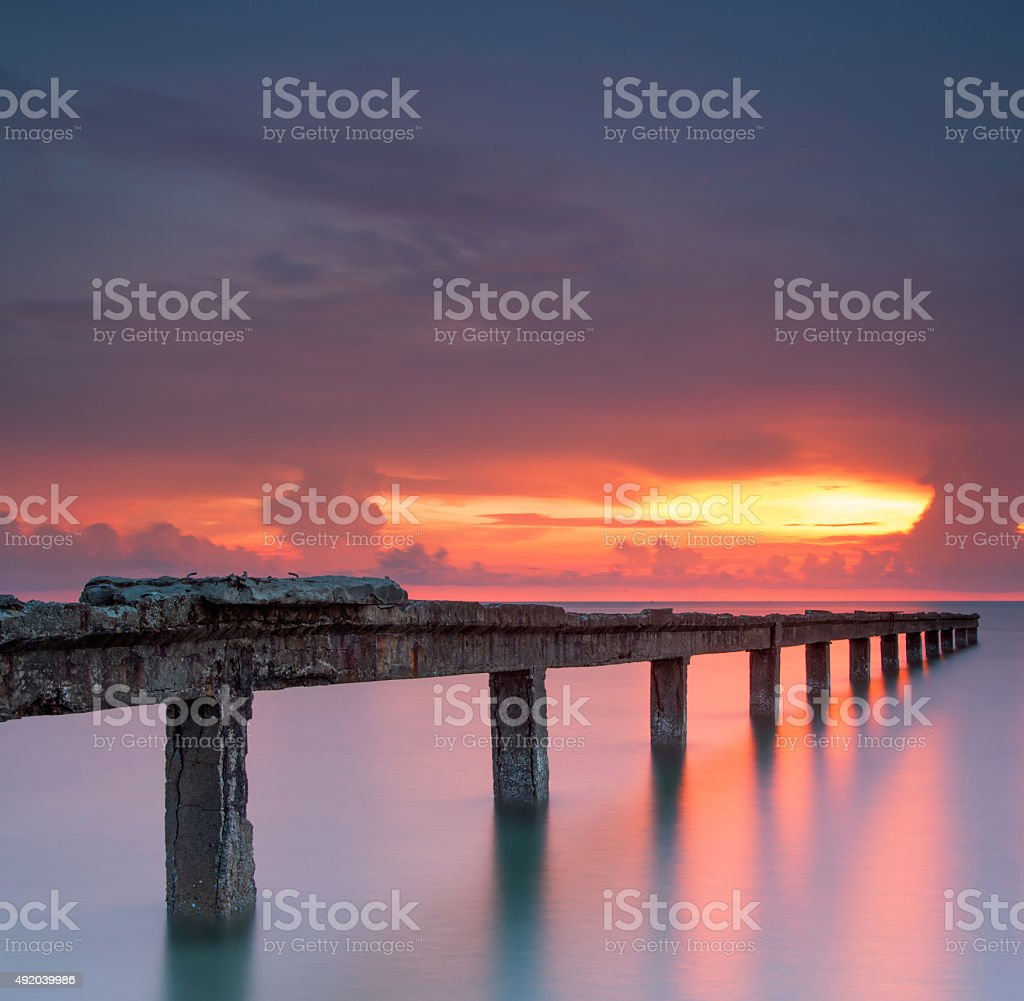 Pier on red sea with beautiful sunrise stock photo