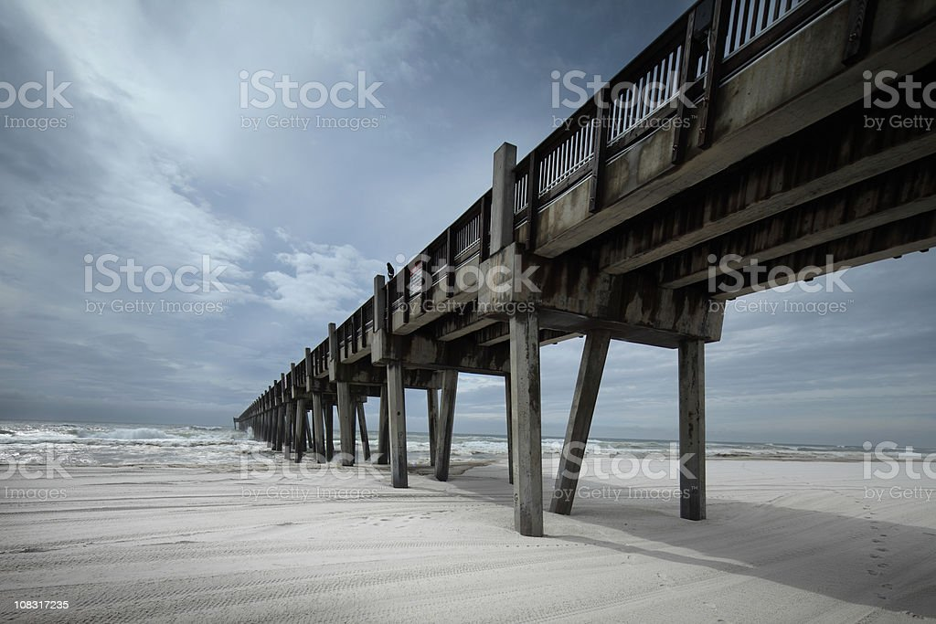 Pier on the beach in Pensacola, Florida. stock photo