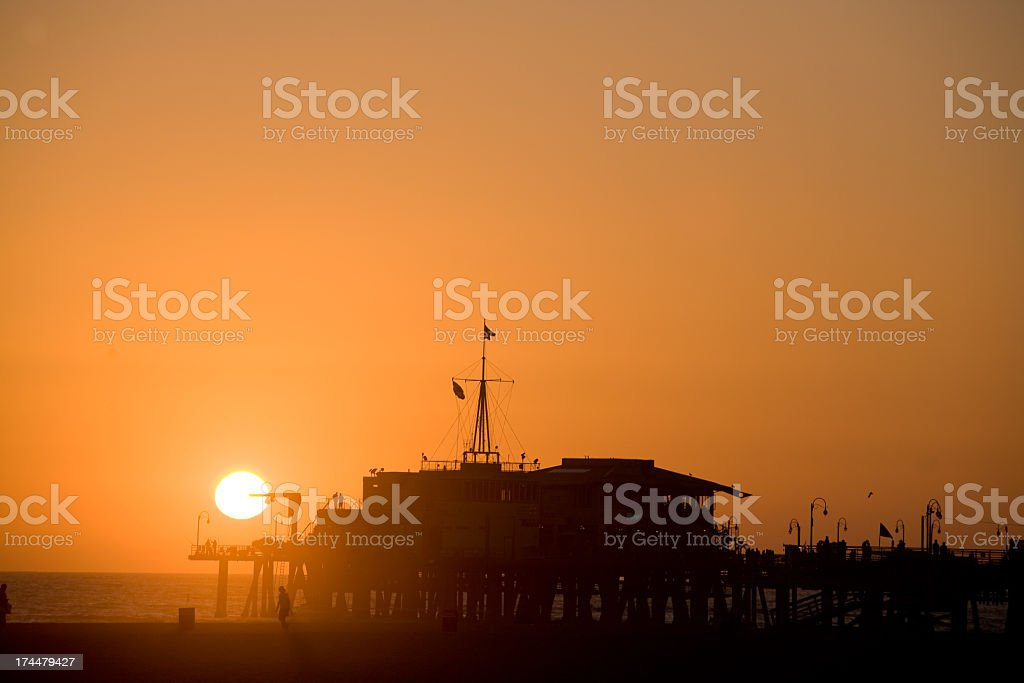 Pier on the beach royalty-free stock photo