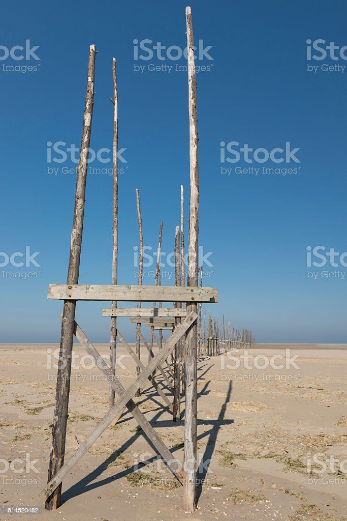 Pier on the sandbar the Vliehors on the island of Vlieland. stock photo
