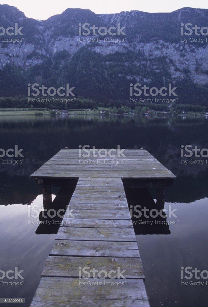 Pier on the shore of Lake Hallstatt stock photo
