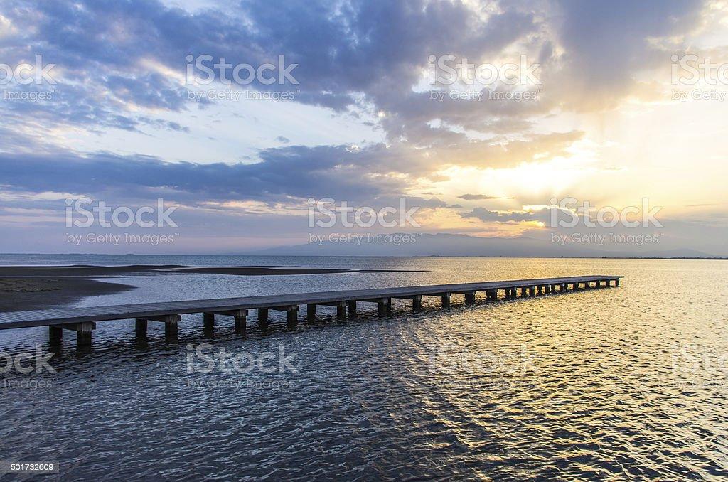 pier over sea in delta del ebro at dusk stock photo