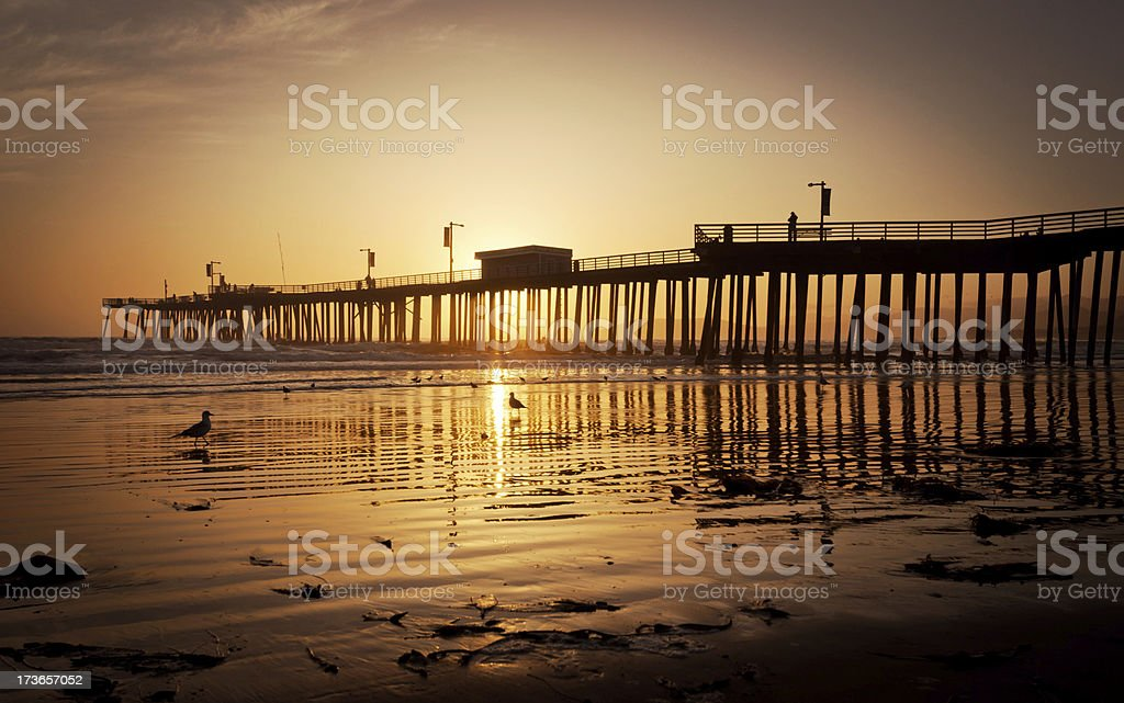 Pier sunset in California royalty-free stock photo