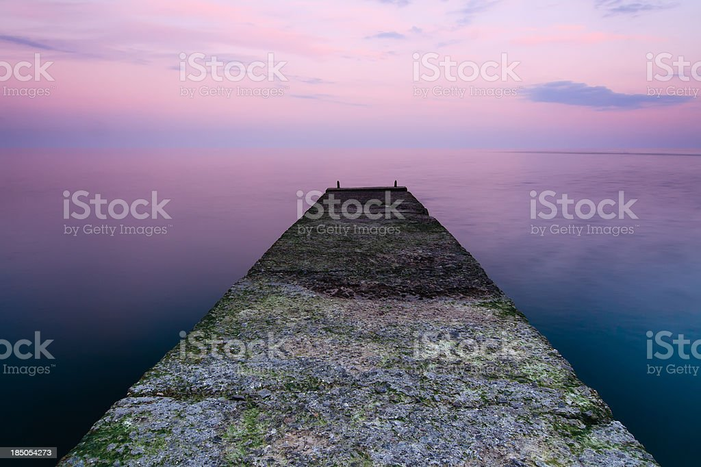 pier that goes into the ocean. royalty-free stock photo