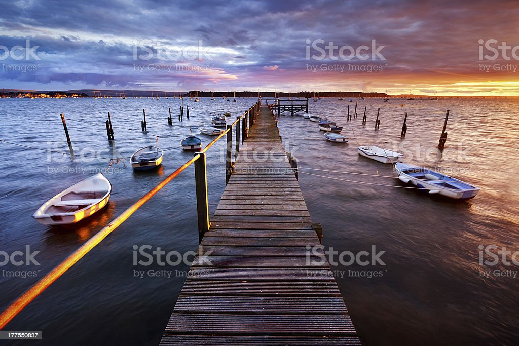 Pier view of the Poole harbor at sunset stock photo