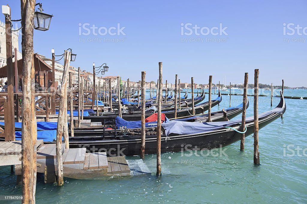 Pier with gondolas, Venice - Italy stock photo