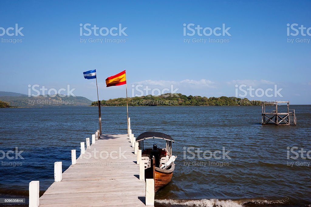 Pier with old wooden boat in Lake Nicaragua stock photo