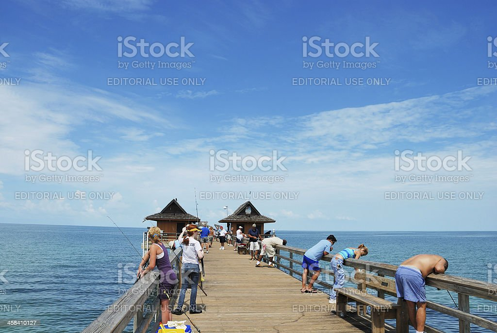 Pier with people fishing at Naples Florida USA stock photo