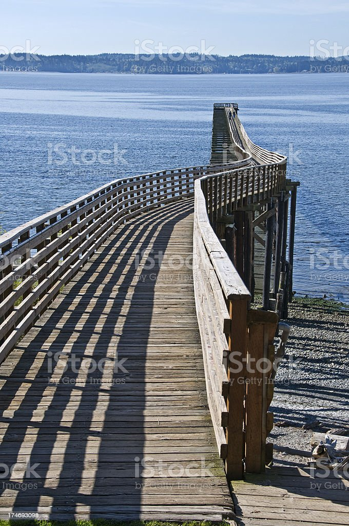 Pier with slight curve in Washington state royalty-free stock photo