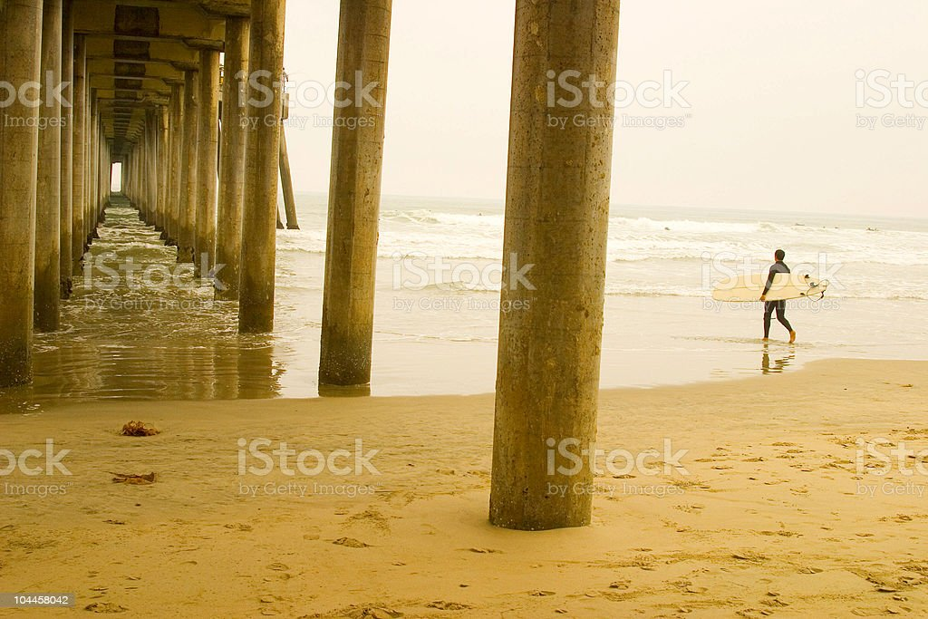 pier with surfer stock photo