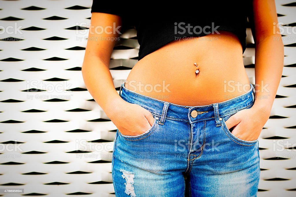 Pierced female belly stock photo