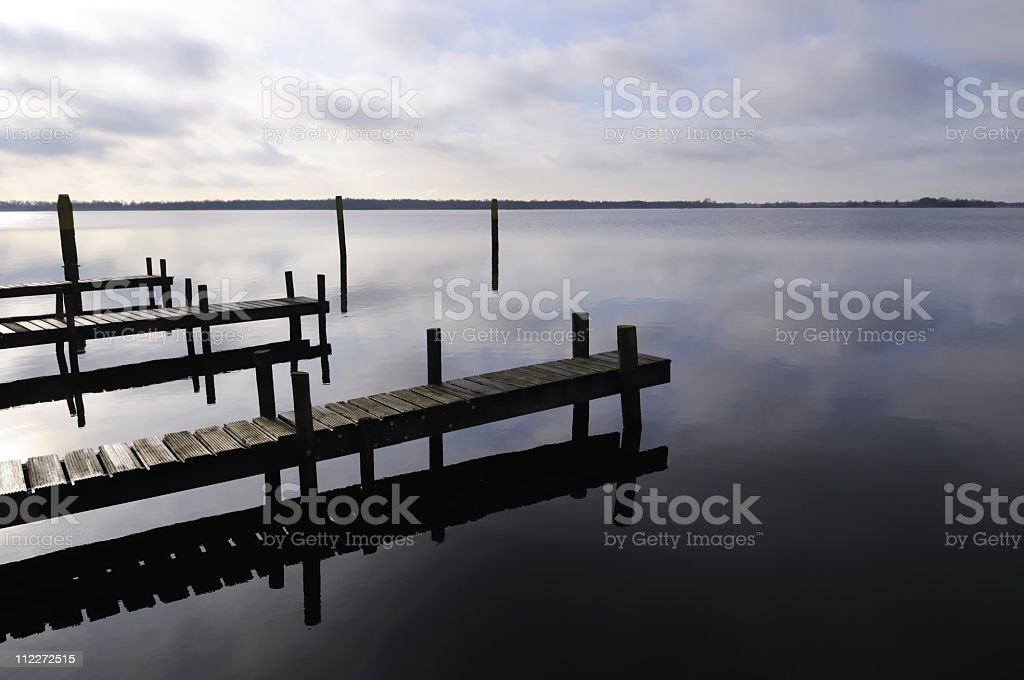 Piers in a lake stock photo