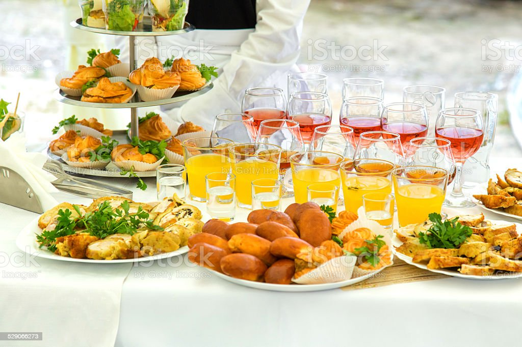 Pies, eclairs and drinks stock photo