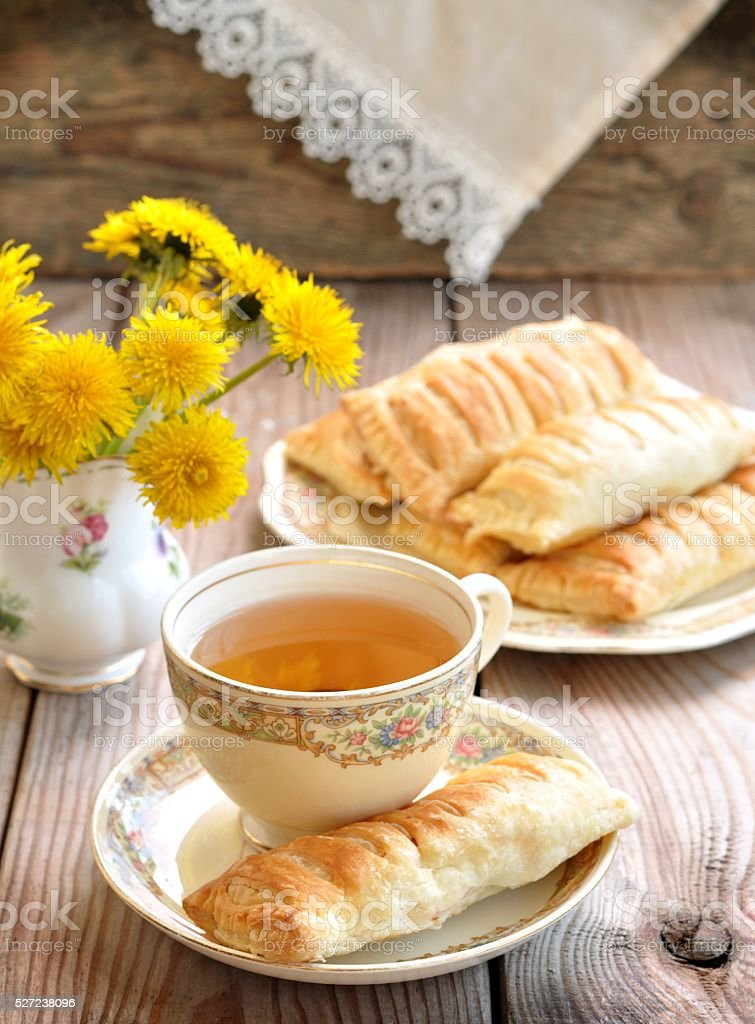 Pies of puff pastry on a wooden table. Vintage style. stock photo