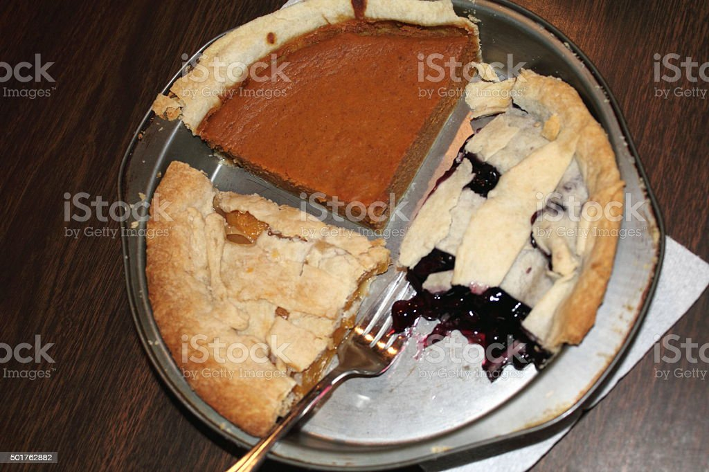 Pies, some of each; pumpkin, blueberry, peach stock photo