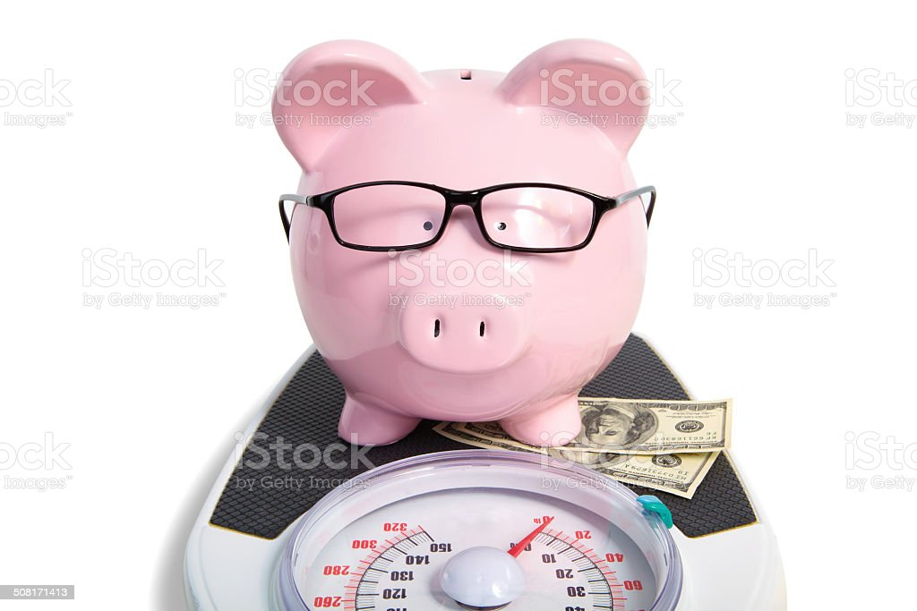 Pig bank and scales stock photo