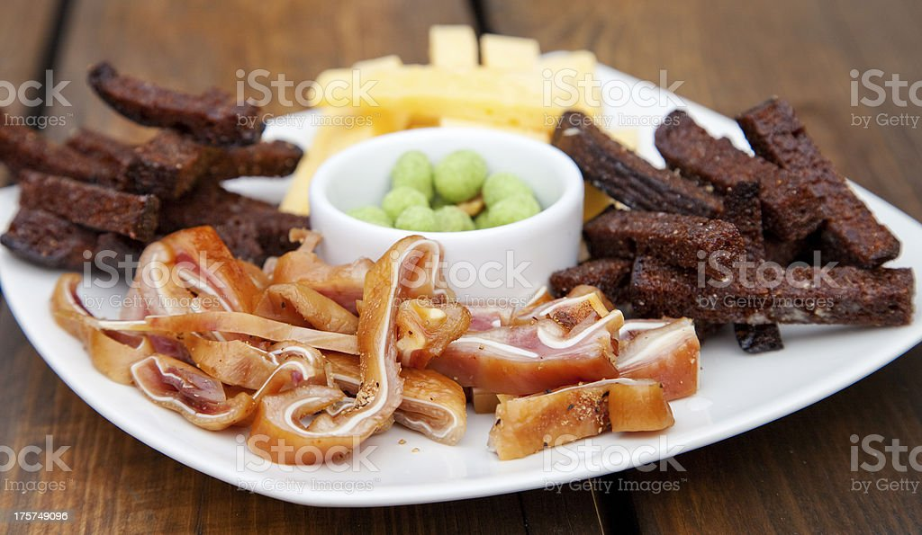 Pig ears and bread stock photo