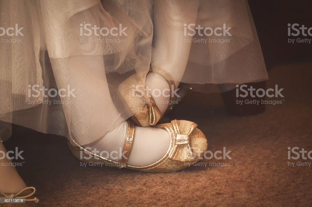 Pigeon toed bridesmaid's feet stock photo