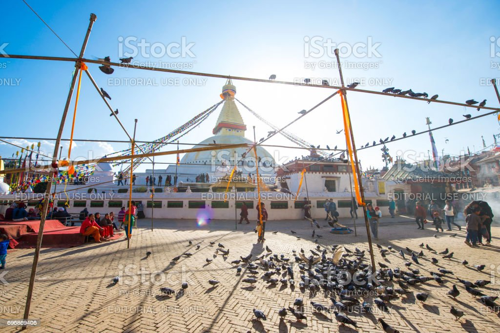 pigeons at Boudhanath Stupa landmark of Kathmandu stock photo