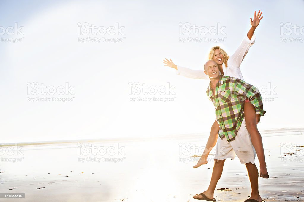 Piggy back at the beach royalty-free stock photo