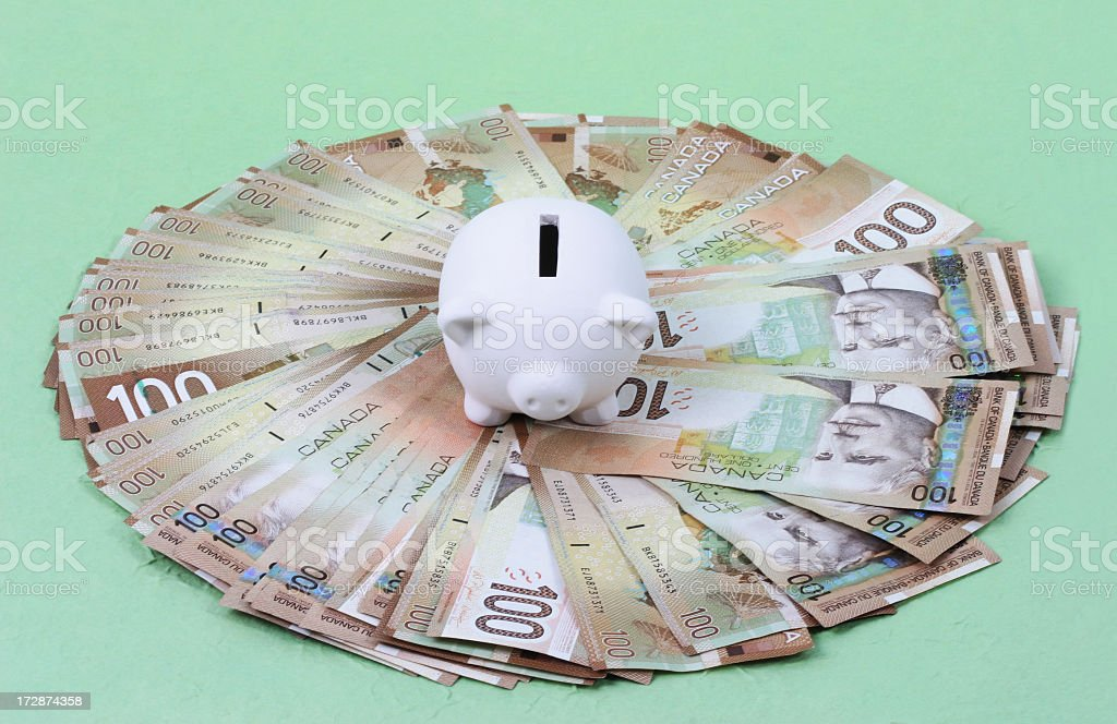 Piggy Bank and Canadian money royalty-free stock photo