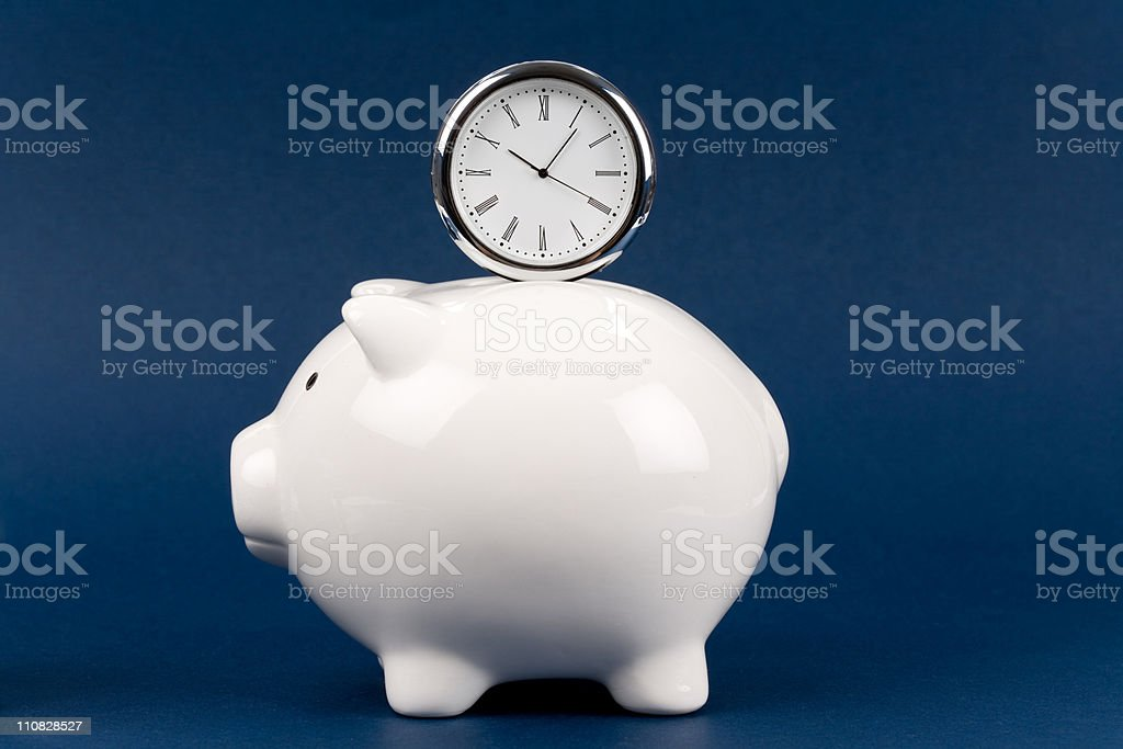 Piggy Bank and clock stock photo