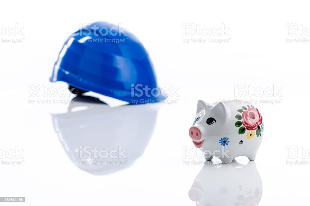 piggy bank and hart hat stock photo