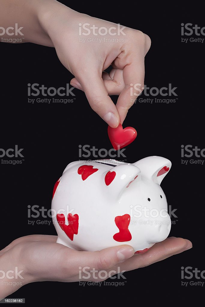 Piggy bank and heart stock photo