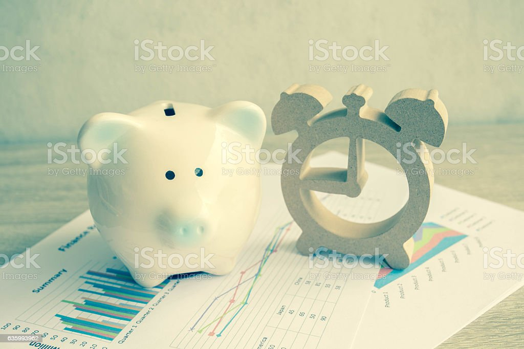 Piggy bank and house model for finance and banking concept. stock photo