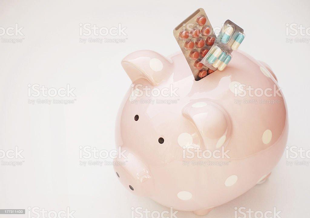 Piggy Bank and Pills stock photo