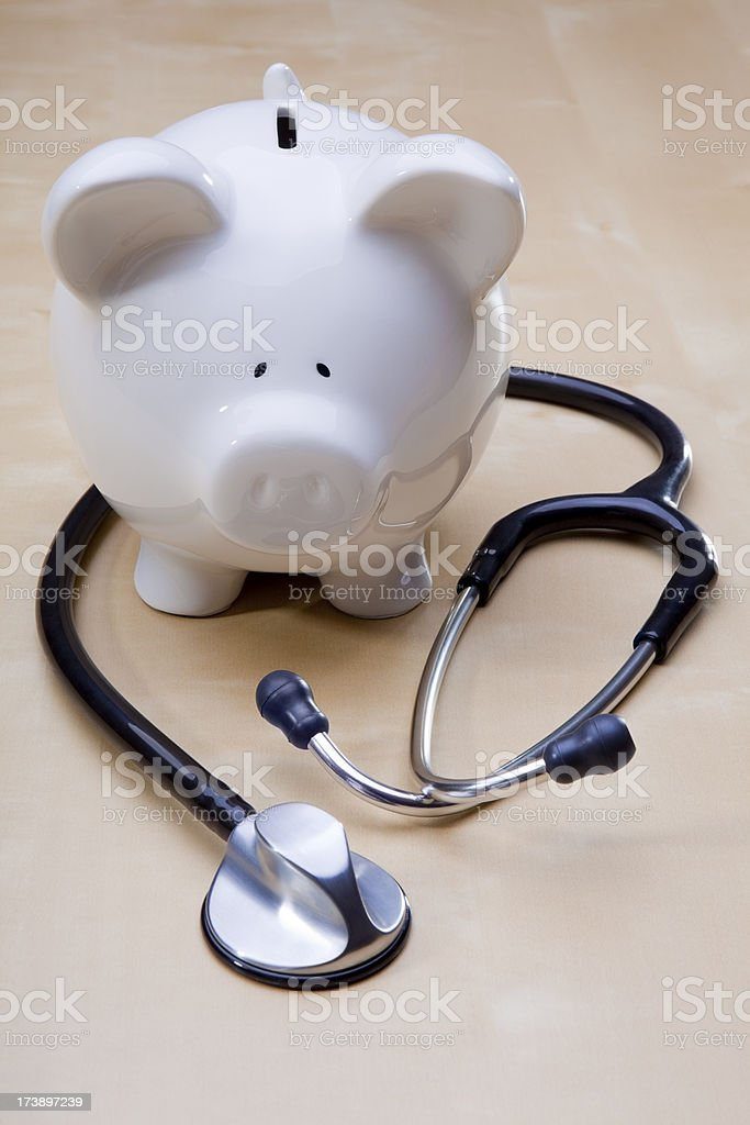 Piggy Bank and Stethoscope royalty-free stock photo