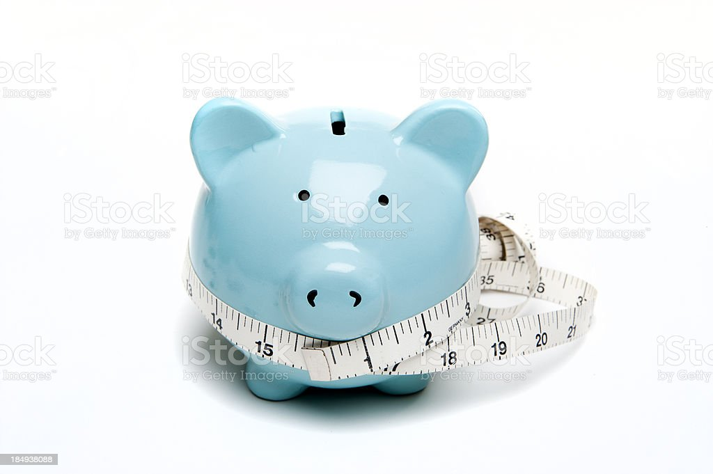 Piggy bank and tape measure stock photo