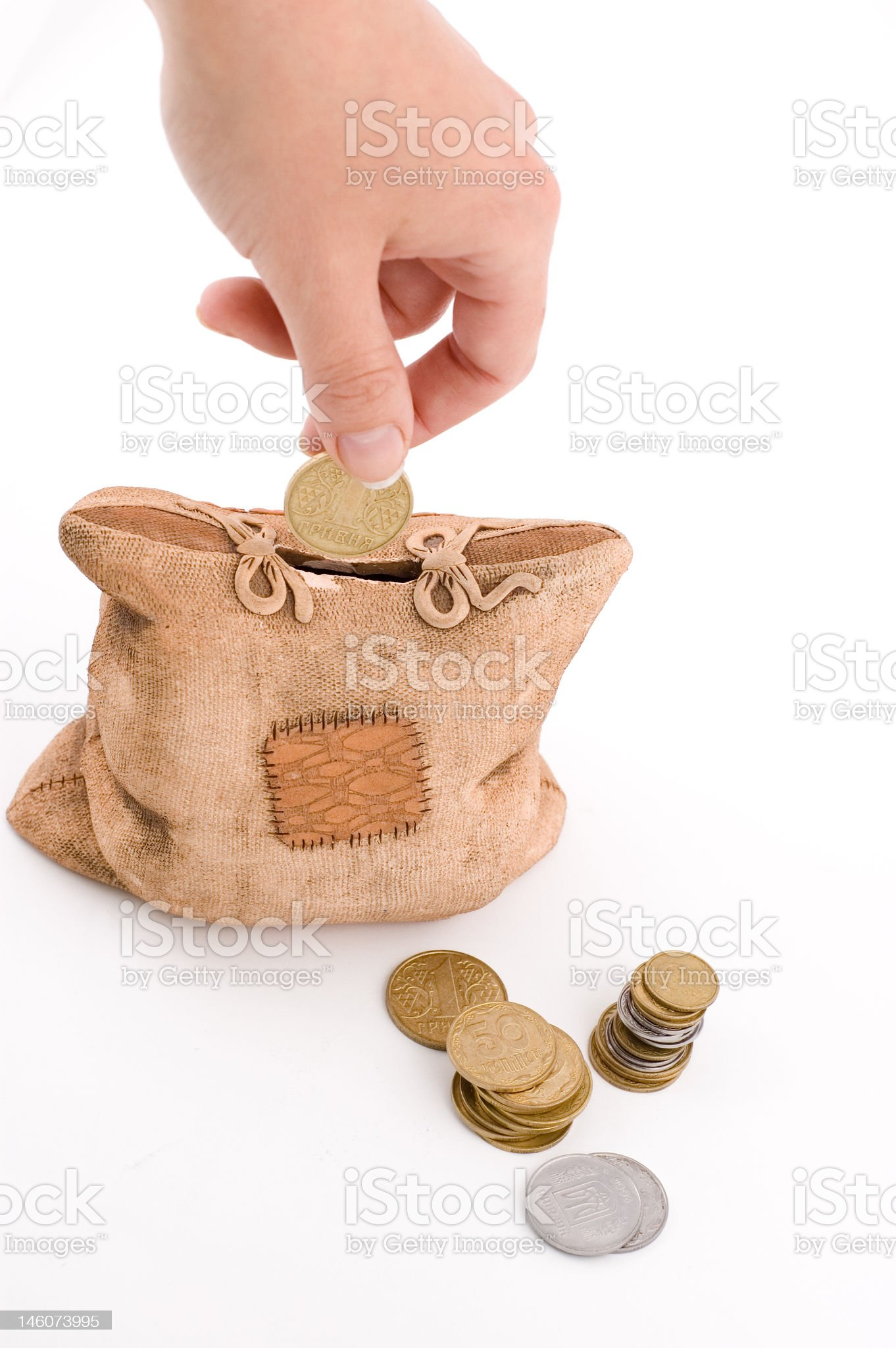 piggy bank and woman's hand royalty-free stock photo