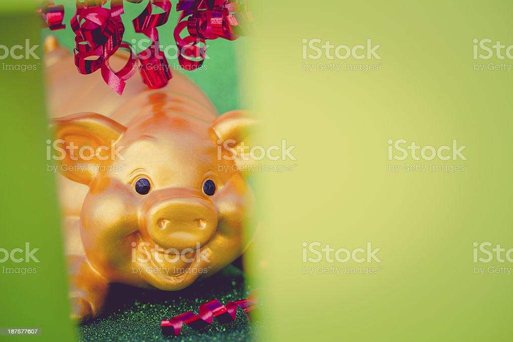 piggy bank behind green christmas box stock photo