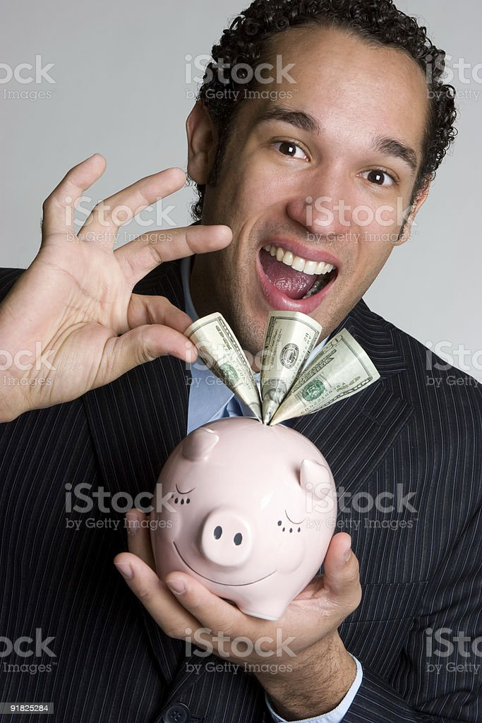 Piggy bank businessman royalty-free stock photo