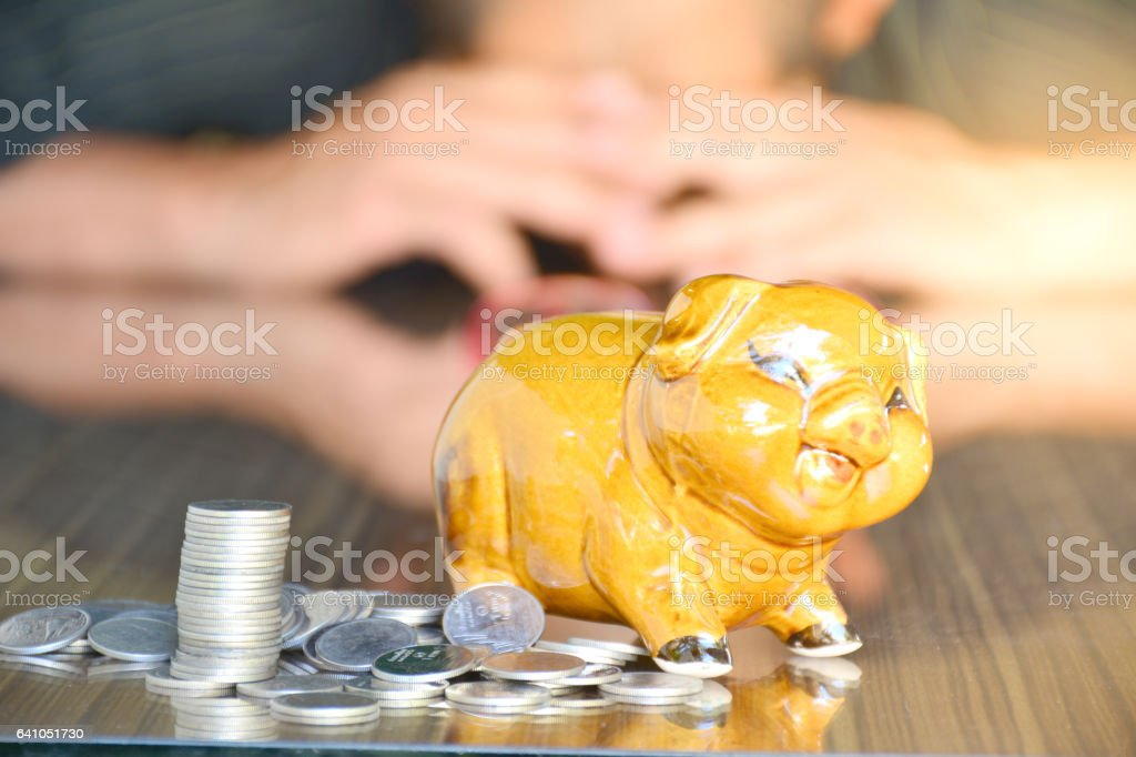 piggy bank, coins and woman on wood desk stock photo