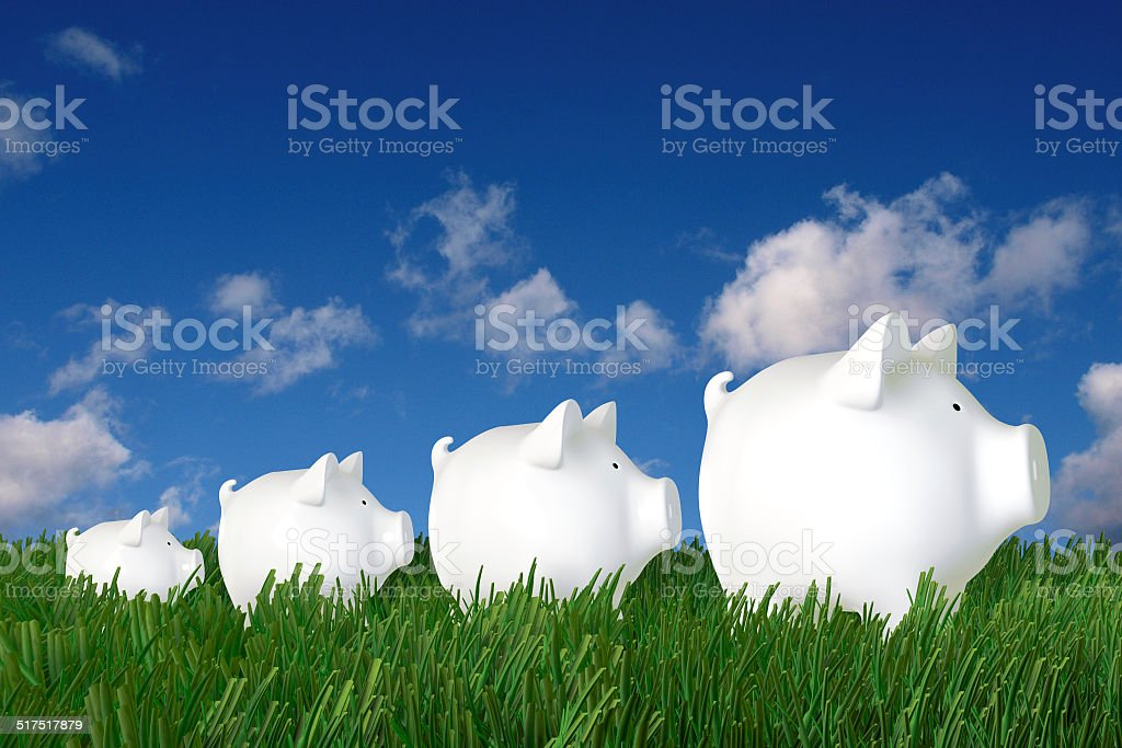 Piggy bank - family walk in the grass stock photo