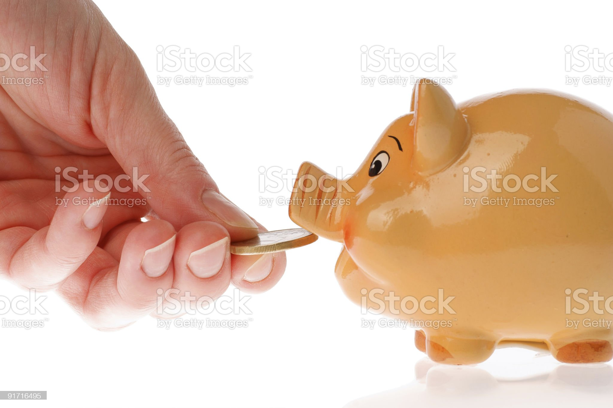 Piggy bank, hand and currency royalty-free stock photo