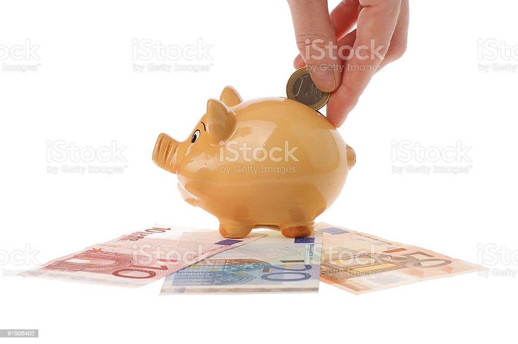 Piggy bank, hand and euro currency royalty-free stock photo