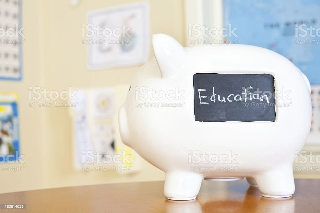 Piggy Bank in Classroom With Education Written on it royalty-free stock photo