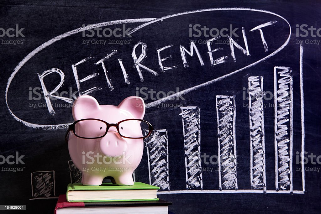 A piggy bank in front of a chalkboard with a savings message royalty-free stock photo