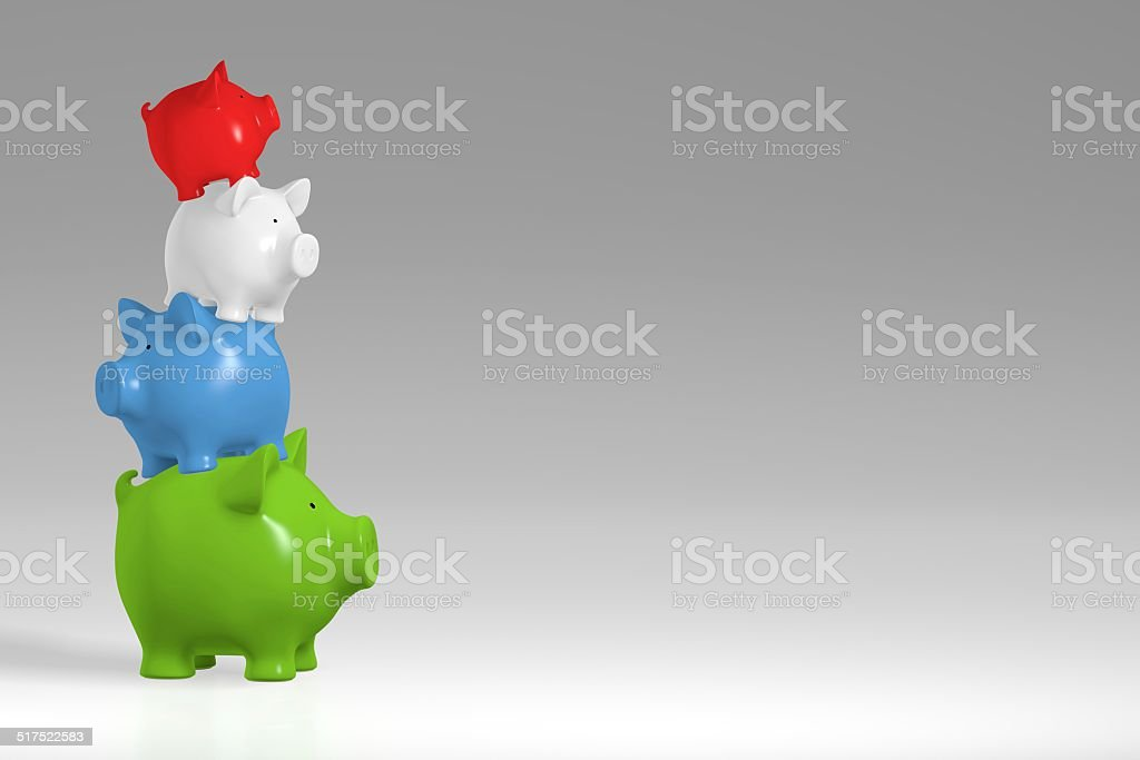 Piggy bank - irregular stack of colored pigs stock photo