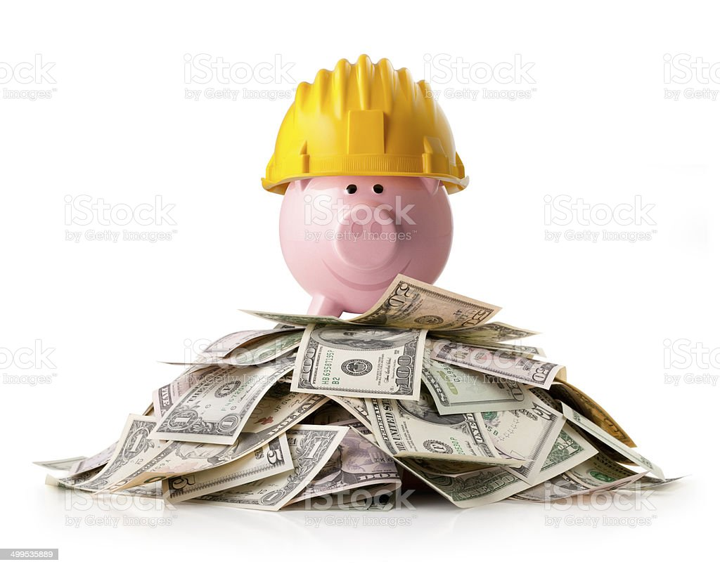 Piggy bank on a pile of dollars banknotes. Concept image. royalty-free stock photo