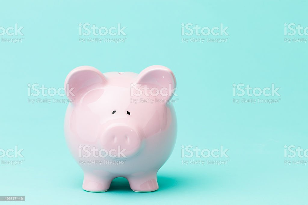 Piggy bank on blue background stock photo