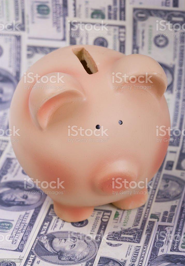 Piggy bank on dollars royalty-free stock photo